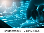Double exposure businessman and stock market or forex graph suitable for financial investment concept. Economy trends background for business idea and all art work design. Abstract finance background. - stock photo