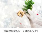 women is holding a small gift... | Shutterstock . vector #718437244