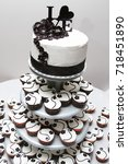 wedding cake and cupcakes.  | Shutterstock . vector #718451890
