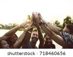 friends hands together unity at ... | Shutterstock . vector #718460656