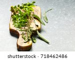herbs on cooking board | Shutterstock . vector #718462486