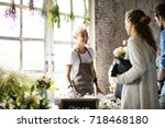 florist selling fresh flowers... | Shutterstock . vector #718468180