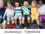 group of diverse kids sitting... | Shutterstock . vector #718469266
