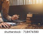 lawyer working hard his job... | Shutterstock . vector #718476580