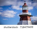 Stock photo clouds roll past a lighthouse in toms river new jersey 718479499