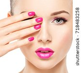 beautiful woman face with pink... | Shutterstock . vector #718483258