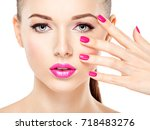 beautiful woman face with pink... | Shutterstock . vector #718483276
