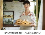 woman with bread at pastry shop ... | Shutterstock . vector #718483540