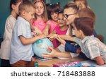 lesson. little schoolchildren... | Shutterstock . vector #718483888