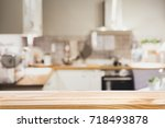 wooden board empty table in... | Shutterstock . vector #718493878
