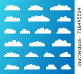 set of white clouds on a blue... | Shutterstock .eps vector #718495534