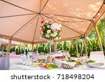 served round banquet table... | Shutterstock . vector #718498204