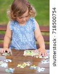 blonde toddler girl  solving... | Shutterstock . vector #718500754