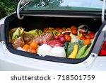 open car trunk full of fresh...   Shutterstock . vector #718501759