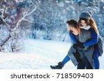 happy loving couple walking in... | Shutterstock . vector #718509403