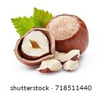 hazelnuts with leaves on a... | Shutterstock . vector #718511440