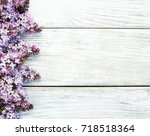 lilac flowers on a old wooden... | Shutterstock . vector #718518364