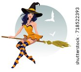 sexy halloween witch with a... | Shutterstock .eps vector #718522393