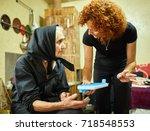 woman preparing the pill case... | Shutterstock . vector #718548553