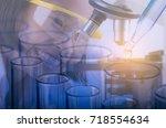 little scientist in laboratory... | Shutterstock . vector #718554634