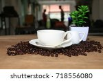 coffee cup and milk jar in... | Shutterstock . vector #718556080