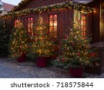 christmas trees at a christmas... | Shutterstock . vector #718575844