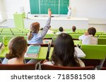 student lifts hand and answers... | Shutterstock . vector #718581508