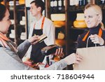 customer paying with credit... | Shutterstock . vector #718604944