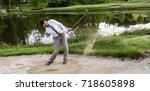 Businessman Golfer In Sand Trap