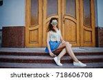 curly stylish girl wear on blue ... | Shutterstock . vector #718606708