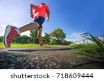 male runner jogging during... | Shutterstock . vector #718609444