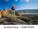 woman hiker reached mountain... | Shutterstock . vector #718619386