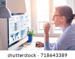 businesswoman looking at... | Shutterstock . vector #718643389