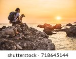 woman with a dog hiking along... | Shutterstock . vector #718645144