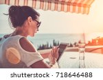 woman sitting on balcony and... | Shutterstock . vector #718646488