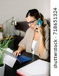 female entrepreneur working... | Shutterstock . vector #718651324