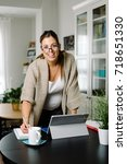 confident pregnant woman... | Shutterstock . vector #718651330