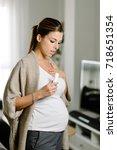 pregnant woman suffering asthma ... | Shutterstock . vector #718651354