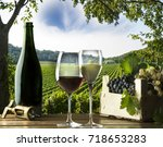 glasses of wine on the wooden... | Shutterstock . vector #718653283