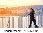 a beautiful young woman running ... | Shutterstock . vector #718660204