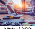 entrepreneur calculating and... | Shutterstock . vector #718660804