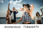 group of friends dancing and... | Shutterstock . vector #718666474