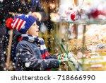 little cute kid boy near sweet...   Shutterstock . vector #718666990