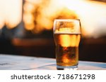refreshing cold lager beer... | Shutterstock . vector #718671298
