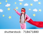 six year blonde girl dressed... | Shutterstock . vector #718671880