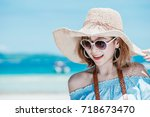 young asian woman wearing... | Shutterstock . vector #718673470