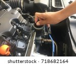men are checking their engines... | Shutterstock . vector #718682164