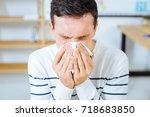 portrait of sick worker that... | Shutterstock . vector #718683850