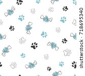 seamless pattern with dog paw... | Shutterstock .eps vector #718695340