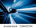 speed driving car in the night... | Shutterstock . vector #718695754